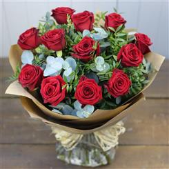 12 Red roses with foliage