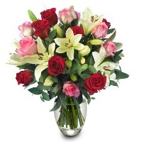 Beautiful flowers in a round bouquet, placed in a vase