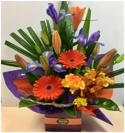 Colourful Orange Gerberas, lilies and Blue Iris